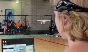 In this April 16, 2016 photo. a University of Florida student uses a brain-controlled interface headset to fly a drone during a mind-controlled drone race in Gainesville, Fla. For more than a century science has been able to detect brainwaves, but recent advances in cheaper equipment like the electroencephalogram, or EEG, headsets worn by the drone racers is moving the technology out of the lab.   (AP Photo/ Jason Dearen)